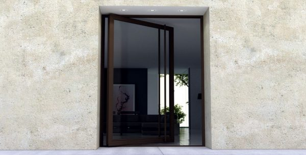 large front door made of glass and bronze with matching door length door hardware