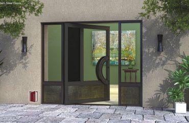 modern entry door made with glass and metal with round door handles and sidelights
