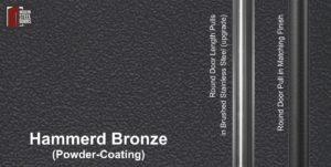 hammered bronze powder-coated paint finish behind round stainless steel door handles and round black door pulls