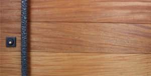 mahogany wooden door with custom round hammered door pulls and black square lock