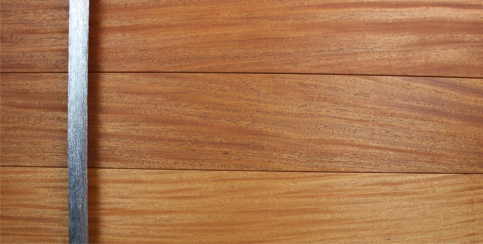 modern wood front door made of genuine mahogany wood and round polished door handles
