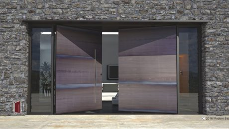 raw steel double pivot entry door made of metal panels with round stainless steel door pulls and sidelights