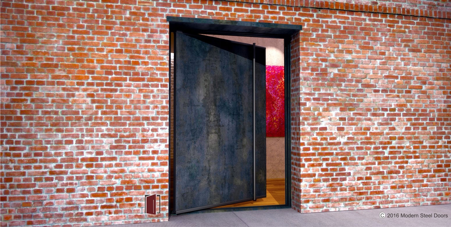 single modern pivot front door made of raw steel and round raw steel full length door hardware on brick home exterior