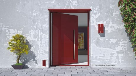 red metal accent pivot front door with square stainless door hardware on modern home