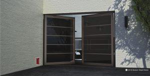 segmented bronze double door made of tinted glass segments and round copper door handles
