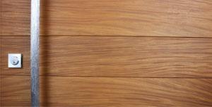 real teak wood door with polished handcrafted door handle and square stainless steel door lock