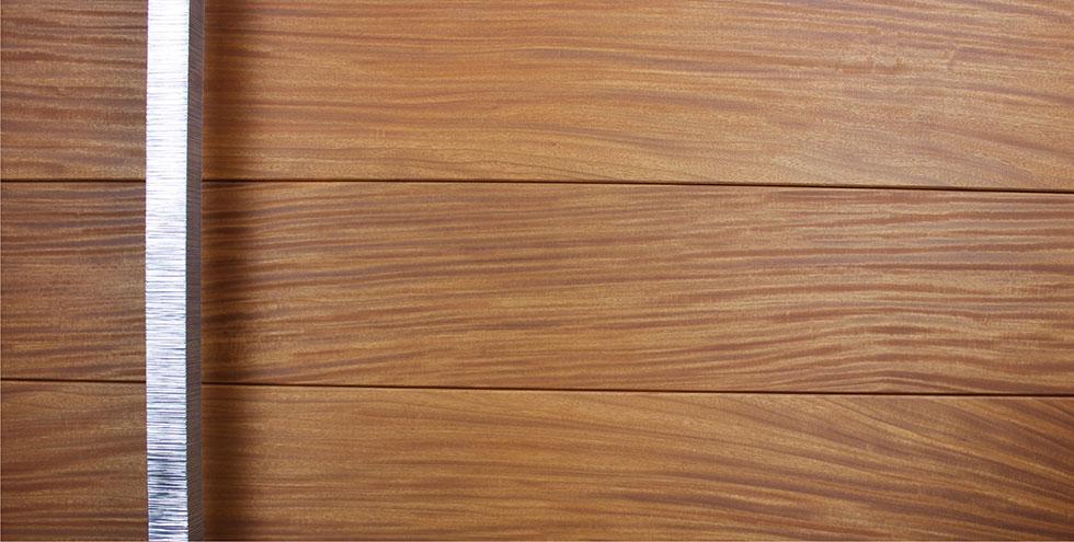 wooden front door made with teak wood and polished custom door accessories