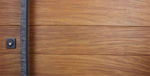 teak genuine wood door behind square modern door handles and black sqaure door lock