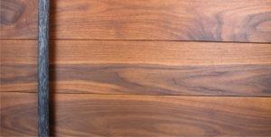 walnut wooden door with round custom modern door hardware