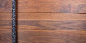 walnut hardwood door with round modern steel door pulls