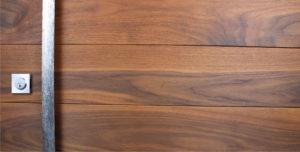 genuine walnut hardwood behind handcrafted door pulls and square stainless steel door lock