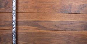 walnut wood exterior door with long round door hardware