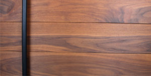 authentic walnut wood door with black powder-coated round door handles