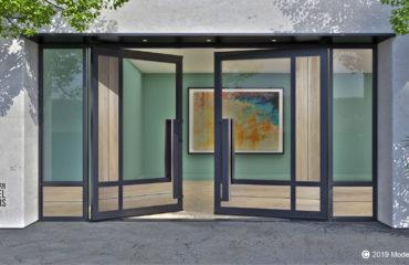 genuine white oak wood and glass front door design with sidelights and unique custom door pulls