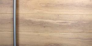 white oak wooden front door with round brushed stainless steel door handle