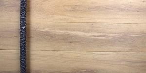 white oak wooden luxury front door behind round dark textured door pull