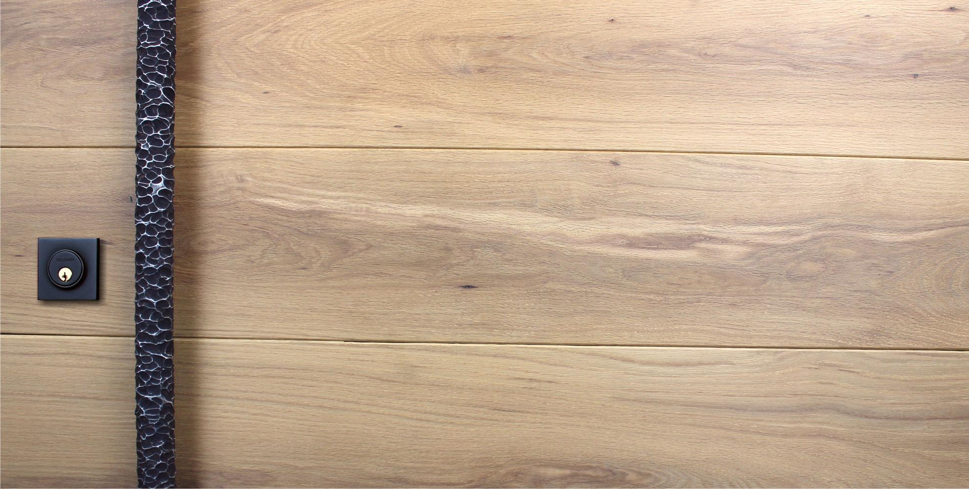 genuine white oak hardwood entry door with matching custom door hardware