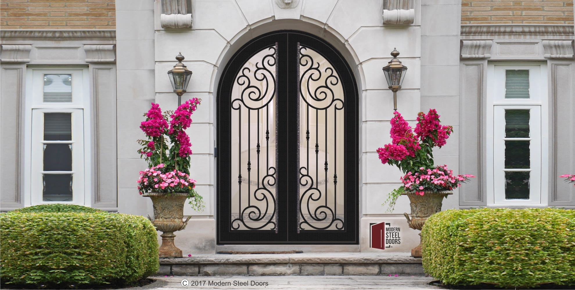 arched transitional double door with scroll design with handmade custom door hardware