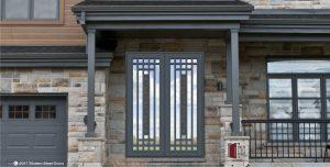 metal and glass transitional double door with custom door pulls and accent door centerpieces on home front