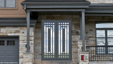metal and glass transitional double door with custom door pulls and accent door centerpieces on home front