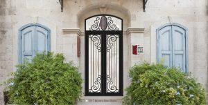 transitional style paris double door front door design with arched transom and handmade custom door hardware