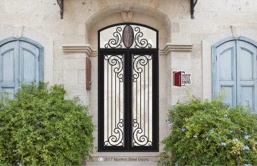 transitional style paris double door front door design with arched transom and handmade custom door hardware