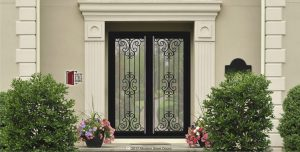 transitional glass and metal pivot double doors with scroll design and round custom made door handles